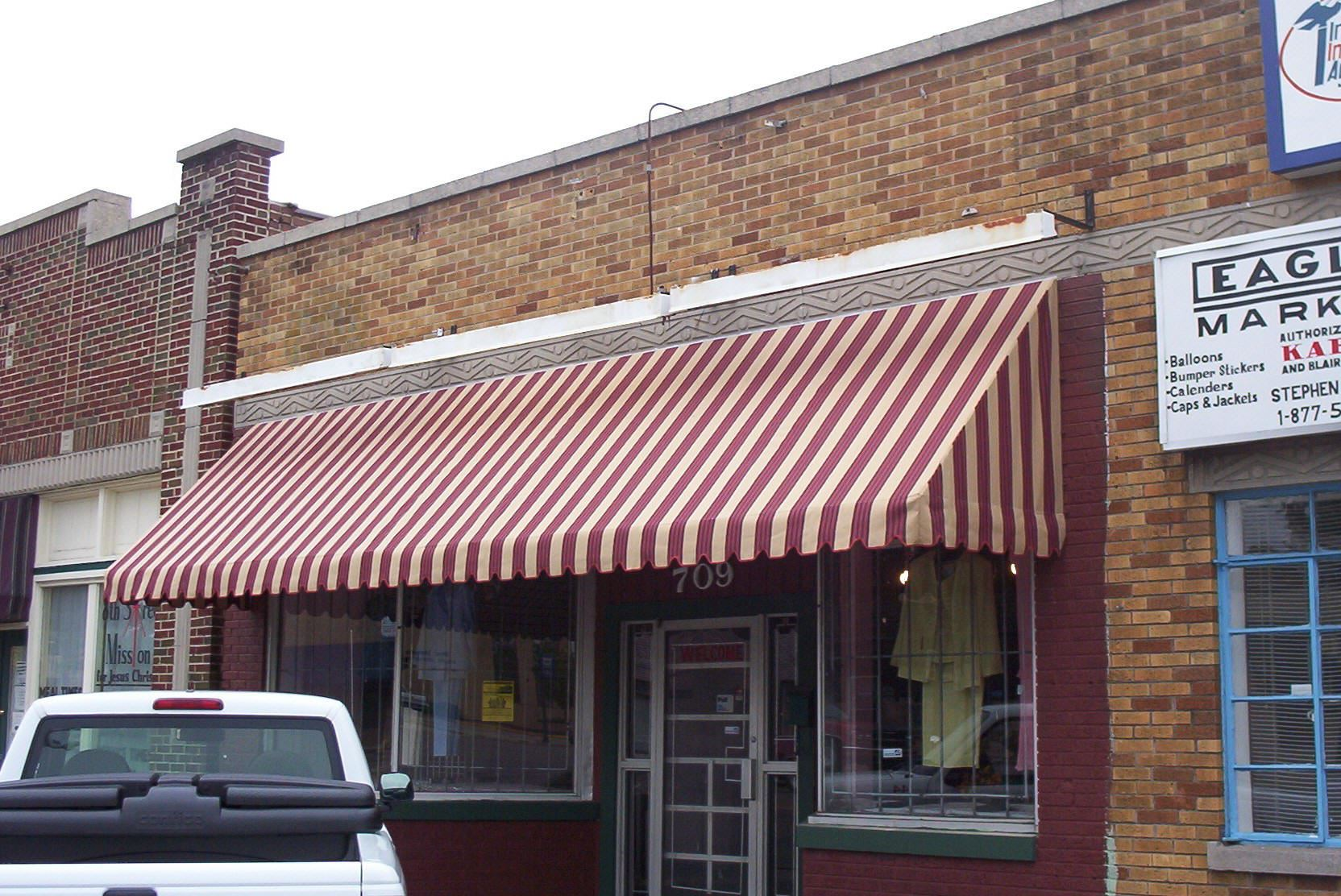 A storefront with a new awning